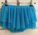 Turkos rynkad kjol med massor av glitter